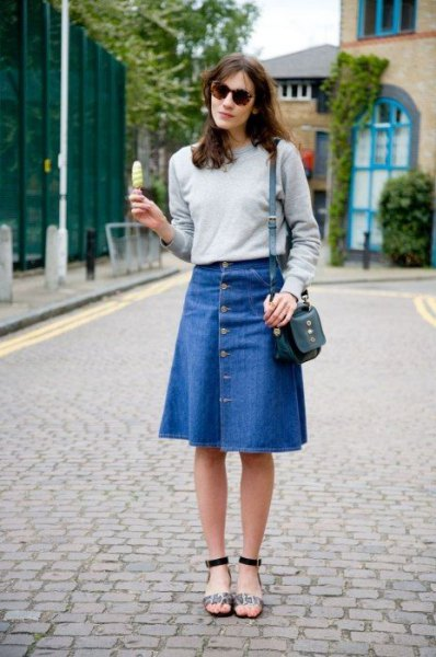 gray sweater with blue denim knee-length skirt