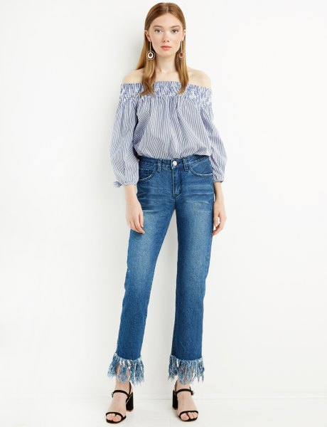 blue and white striped of the blouse with fringed jeans