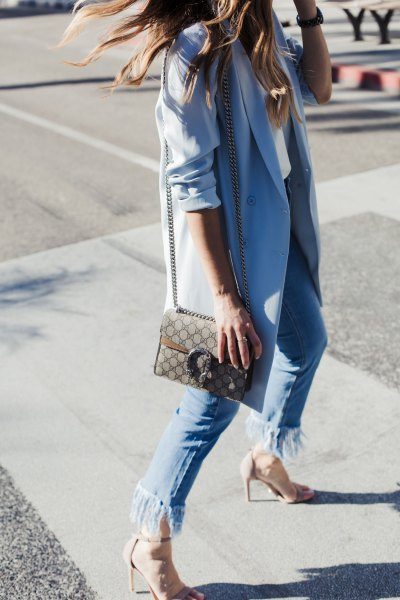 Sky blue long blazer with fringed jeans