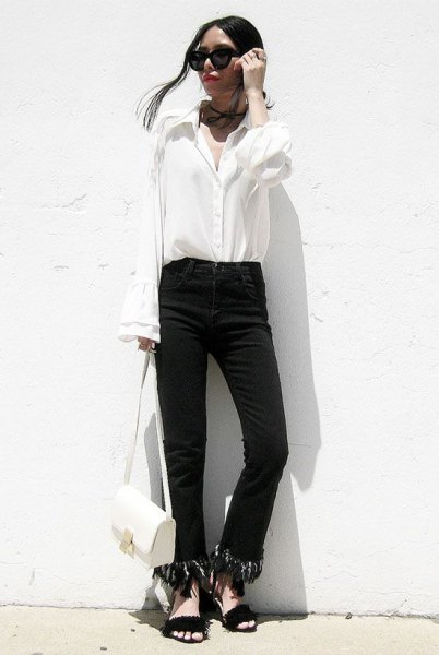 black fringed jeans with white button up bell neck shirt