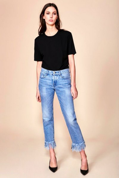 black t-shirt with cropped blue fringed jeans