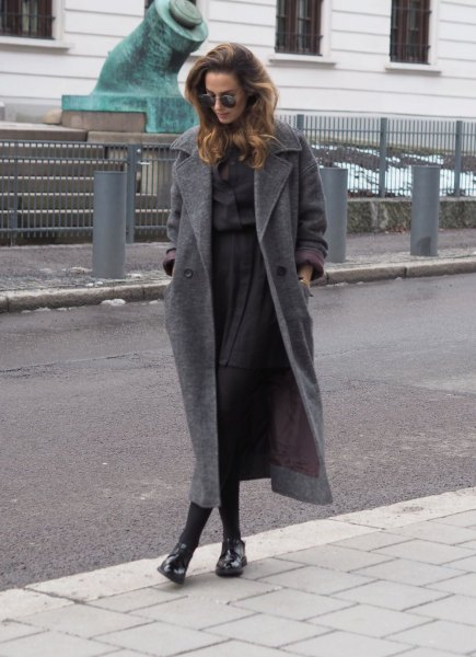 gray wool maxi jacket with button up shirt and pleated miniskirt