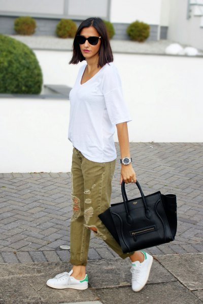 white big tee with green ripped khaki jeans