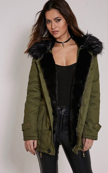 black shoe neck vest with fur lined parka