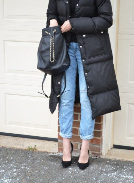 black mid-length puffer skirt with blue cuffed jeans