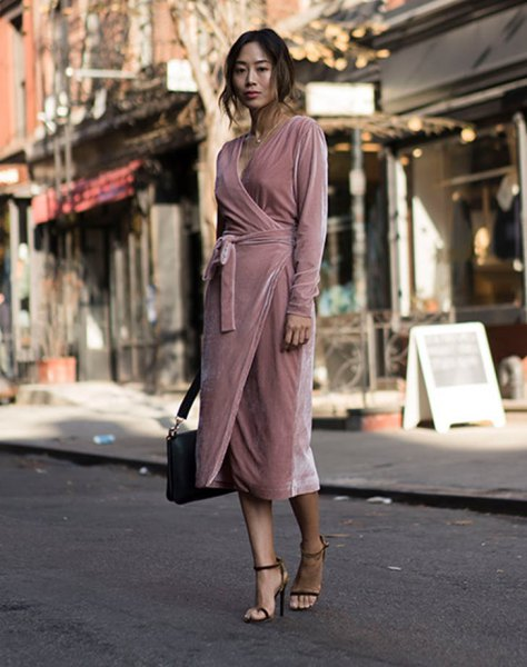 light pink midi velvet wrap dress with black briefcase and heels