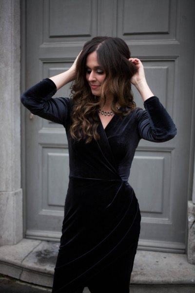 black velvet knee-length dress with silver statement necklace