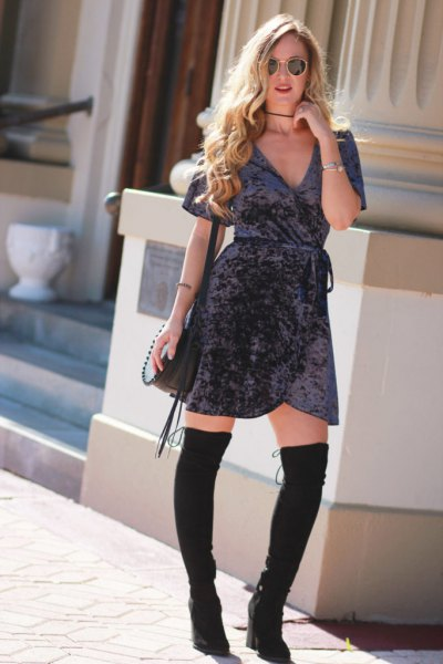 gray mini velvet wrap dress with black thigh high boots