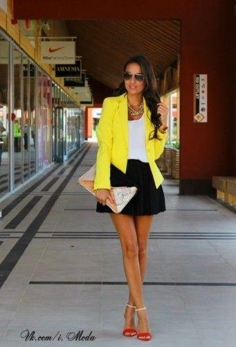 yellow blazer with white tank and black mini skater skirt