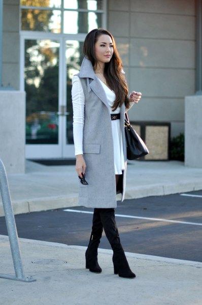white belted mini dress with gray sleeveless long jacket