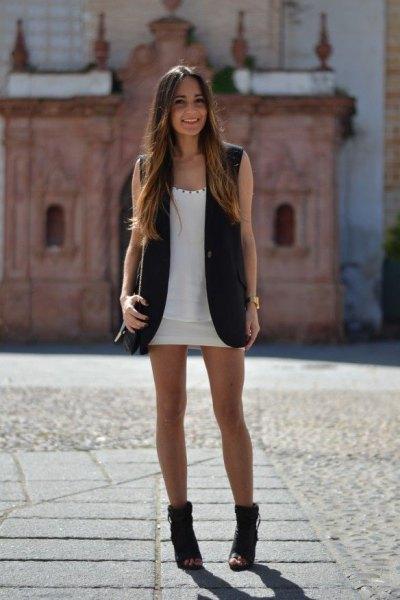 white scoop neck mini dress with black long sleeve jacket