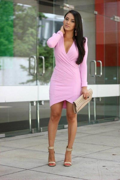 light pink long sleeve dress with leather clutch