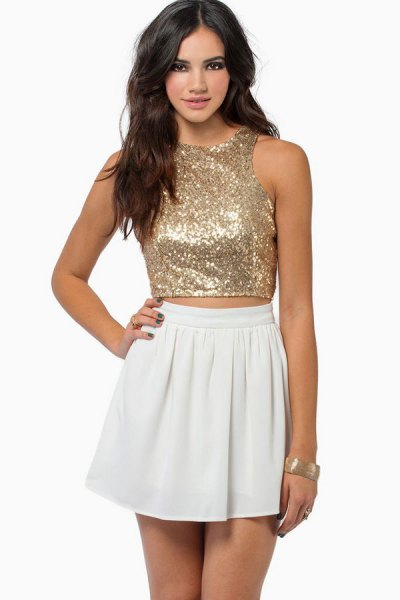 pink gold sequin cropped vest top with white mini skater dress