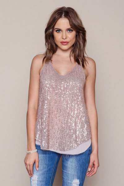 bow gold sequin vest with blue jeans