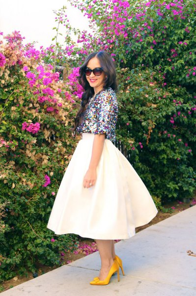 silver half-sleeved top with white midi-flared skirt