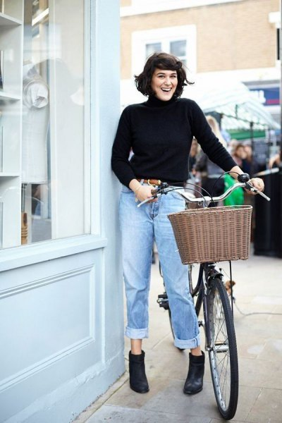 black sweater neck shirt with blue cuffed high waist jeans
