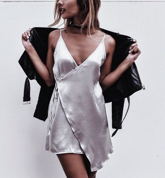 white deep v-neck silk mini wrap dress with leather jacket