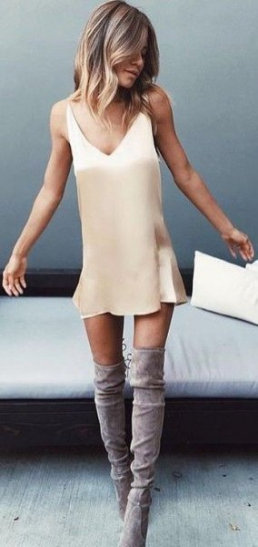 blush pink mini slip dress with gray suede high boots
