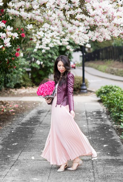 blush pink maxi pleated deferred dress with black leather jacket