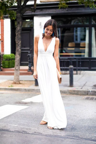 white deep v-neck gathered midi dress with silver heels