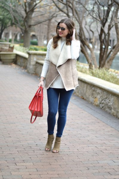 gray vest with white tee and blue skinny jeans