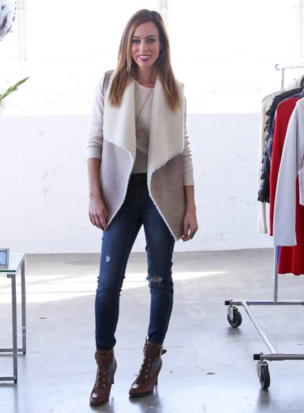 gray shearling vest with ripped skinny jeans and combat boots