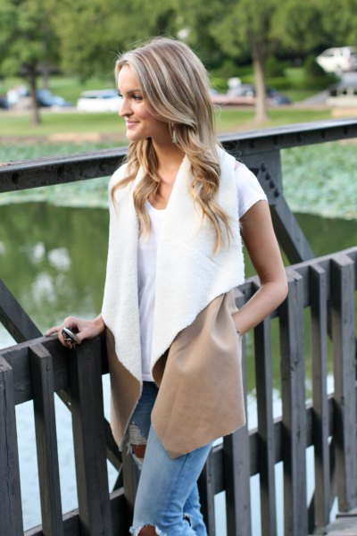 white shearling vest with t-shirt and jeans