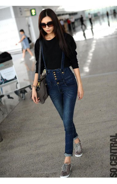 black knit sweater with dark blue button front jeans