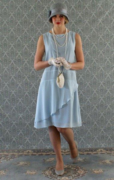 teal ruffle gatsby style midi dress with gray felt hat