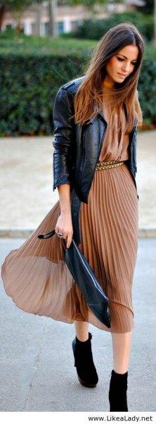 green pleated chiffon midi dress with black leather jacket