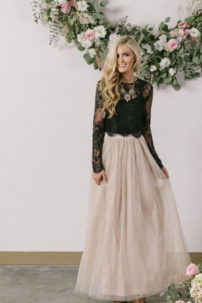 black peeled top in lace case with light pink tulle floor length skirt