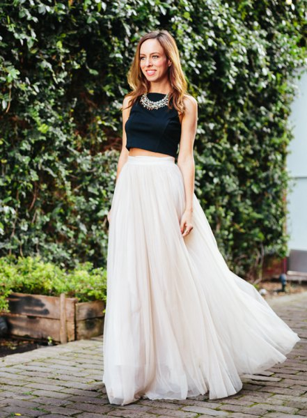 black cropped sleeveless top with pink pink long chiffon skirt
