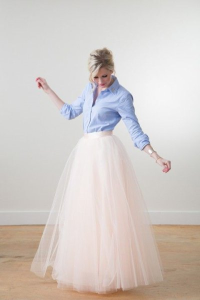 light blue button up shirt with white high floor length flowing skirt