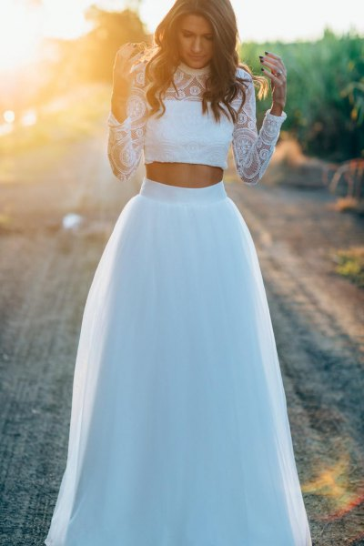 white lace cropped blouse with long waist long white tulle skirt