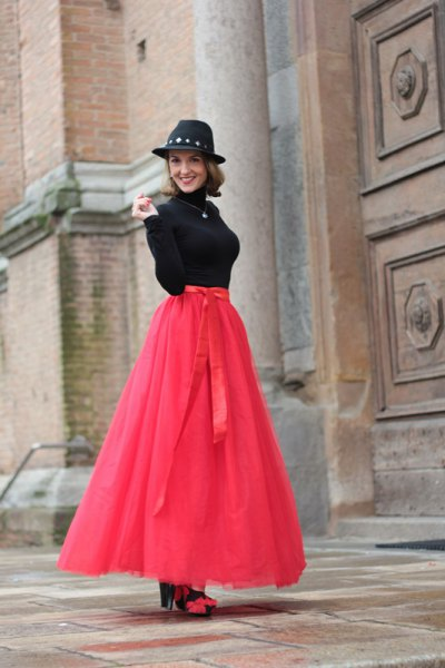 neon pink long tulle skirt with black sweater and felt hat