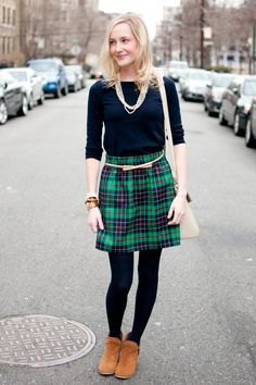 black half-heated tee with green and navy checkered mini skirt