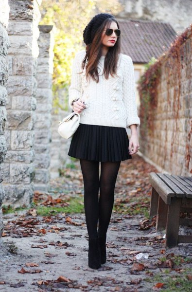 white knitted sweater with black mini pleated skirt