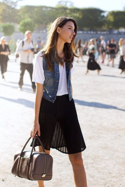 black semi-colored mini pleated skirt with white tee and denim vest