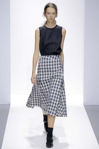 black sleeveless silk top with midi plaid skirt