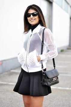 white mesh jacket over black skater mini dress
