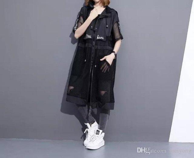 black long mesh skirt over white tee and gray jeans