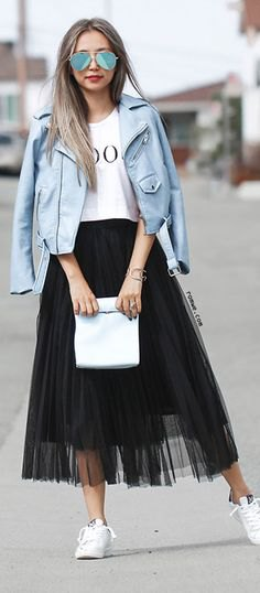 white print tee with teal leather jacket and black mesh skirt