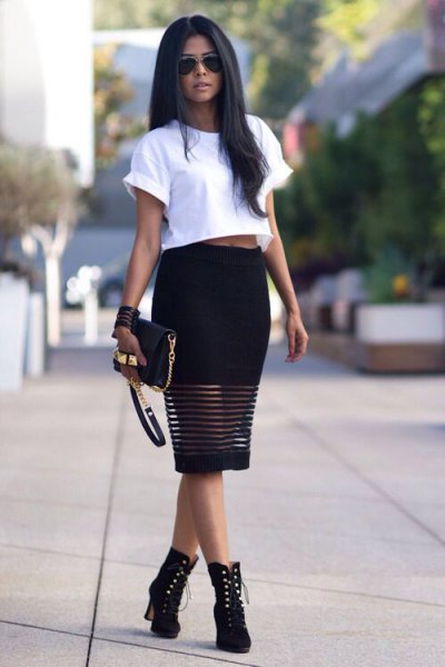 white cropped t-shirt with black midi dress and boots