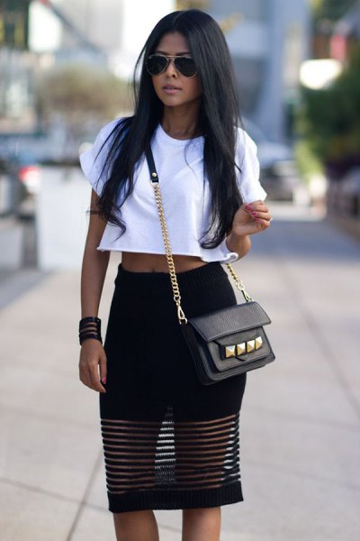 white cropped t-shirt with black mesh knee length skirt