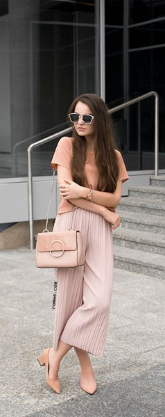 pink t-shirt with red pleated elastic waist pleated trousers