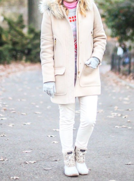light pink faux fur collar long jacket with skinny jeans and white duck boots