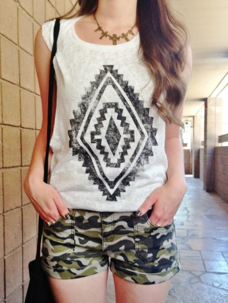 white sleeveless print tee with camo mini shorts