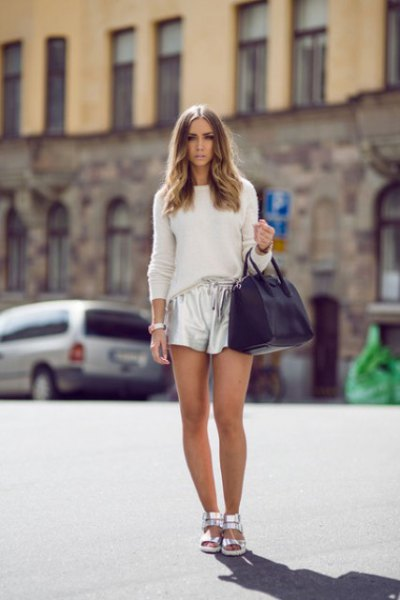 white fitted knit sweater with silver metal shorts