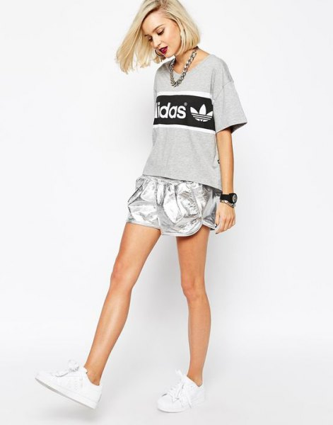 gray print tee with silver shorts and white sneakers