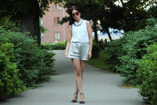 white sleeveless shirt with silver metallic mini-shorts